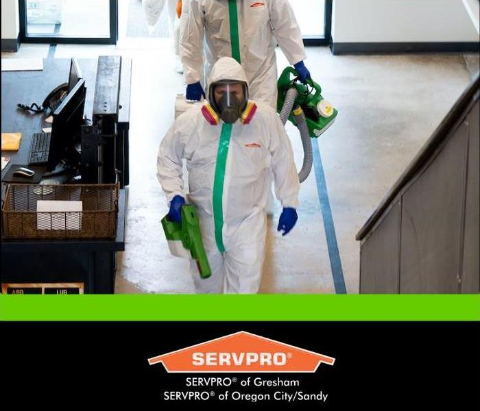 servpro technicians cleaning in PPE