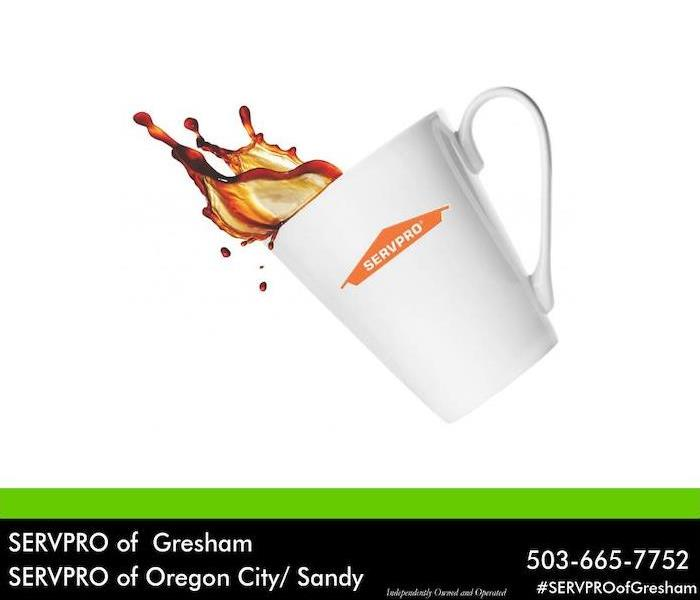 White coffee mug with orange SERVPRO logo on it. Coffee is spilling out of the mug.