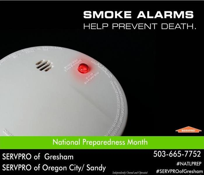 Smoke alarm on black background.