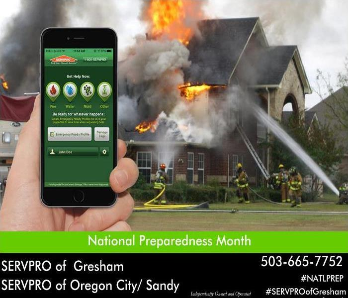 Phone with SERVPRO Emergency ready plan with home on fire in the background.